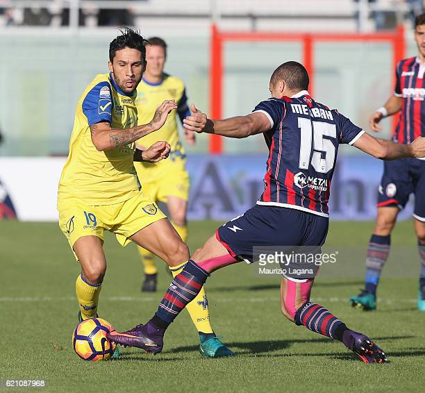 Djamel Mesbah competes for the ball with Lucas Castro of Chievo during the Serie A match between FC Crotone and AC ChievoVerona at Stadio Comunale...
