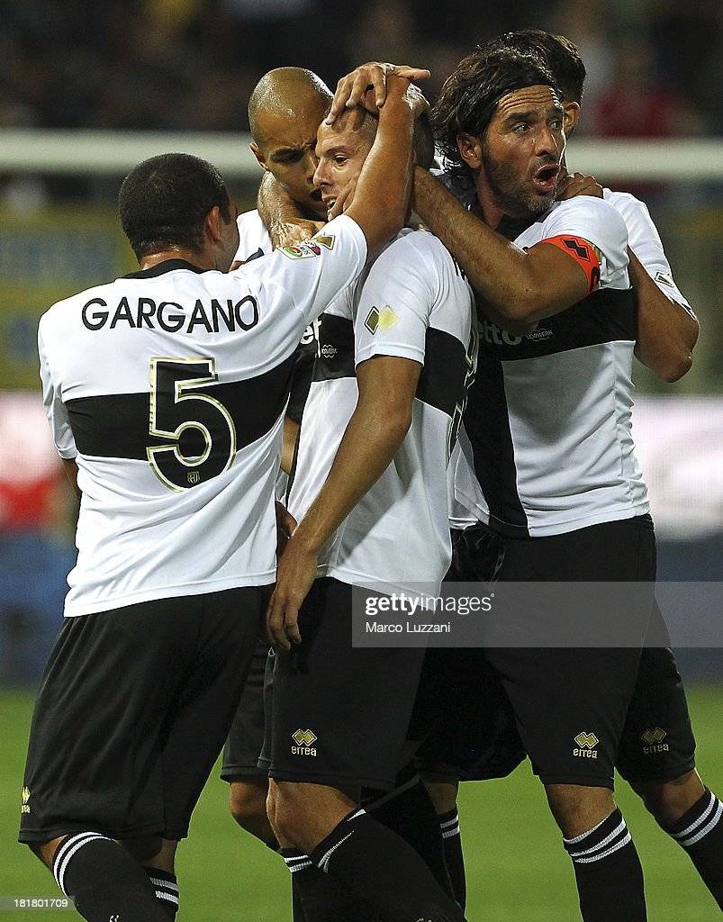 <a gi-track='captionPersonalityLinkClicked' href=/galleries/search?phrase=Djamel+Mesbah&family=editorial&specificpeople=6693283 ng-click='$event.stopPropagation()'>Djamel Mesbah</a> (C) of Parma FC celebrates with his team-mates after scoring the opening goal during the Serie A match between Parma FC and Atalanta BC at Stadio Ennio Tardini on September 25, 2013 in Parma, Italy.