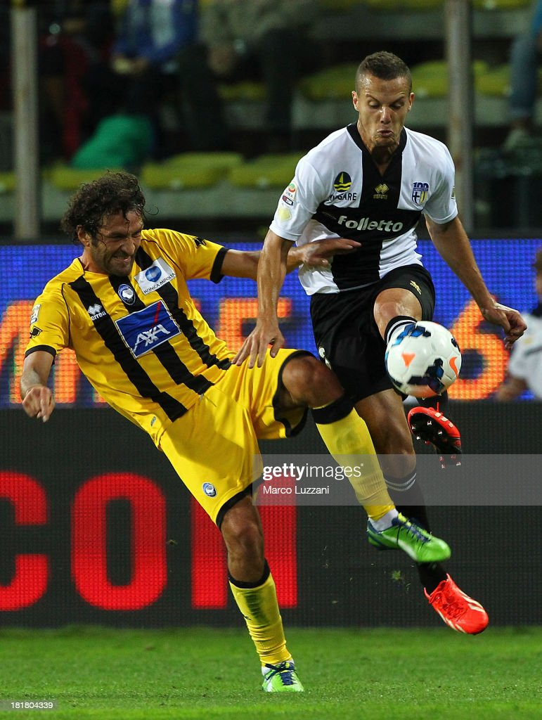 <a gi-track='captionPersonalityLinkClicked' href=/galleries/search?phrase=Djamel+Mesbah&family=editorial&specificpeople=6693283 ng-click='$event.stopPropagation()'>Djamel Mesbah</a> (R) of Parma FC competes for the ball with Cristin Raimondi (L) of Atalanta BC during the Serie A match between Parma FC and Atalanta BC at Stadio Ennio Tardini on September 25, 2013 in Parma, Italy.