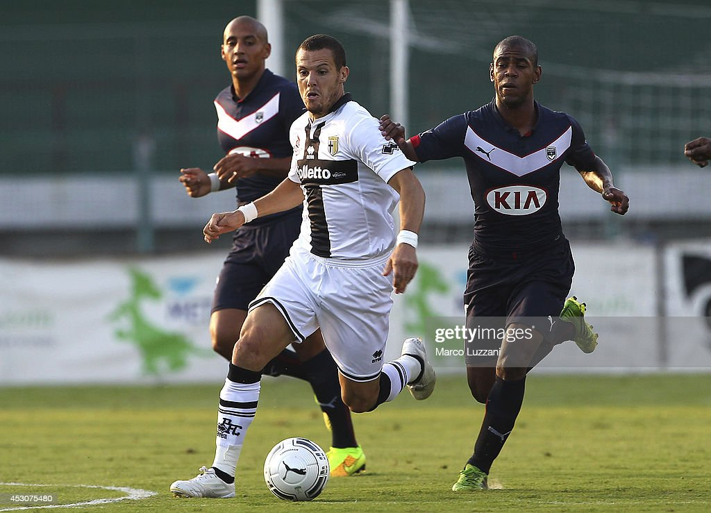 <a gi-track='captionPersonalityLinkClicked' href=/galleries/search?phrase=Djamel+Mesbah&family=editorial&specificpeople=6693283 ng-click='$event.stopPropagation()'>Djamel Mesbah</a> of Parma FC competes for the ball with Diego Rolan Silva of FC Girondins de Bordeaux during a pre-season tournament match between Parma FC, US Avellino and FC Girondins de Bordeaux at Stadio Partenio on August 2, 2014 in Avellino, Italy.