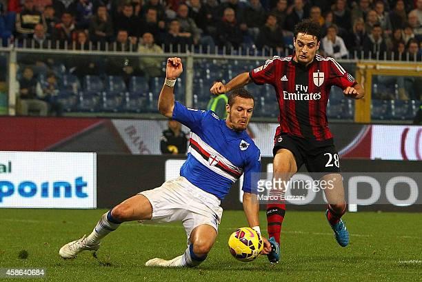 Djamel Mesbah of UC Sampdoria handballs under pressure from Giacomo Bonaventura of AC Milan to concede a penalty during the Serie A match between UC...