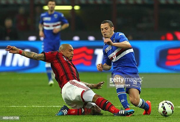 Djamel Mesbah of UC Sampdoria is challenged by Nigel De Jong of AC Milan during the Serie A match between AC Milan and UC Sampdoria at Stadio...