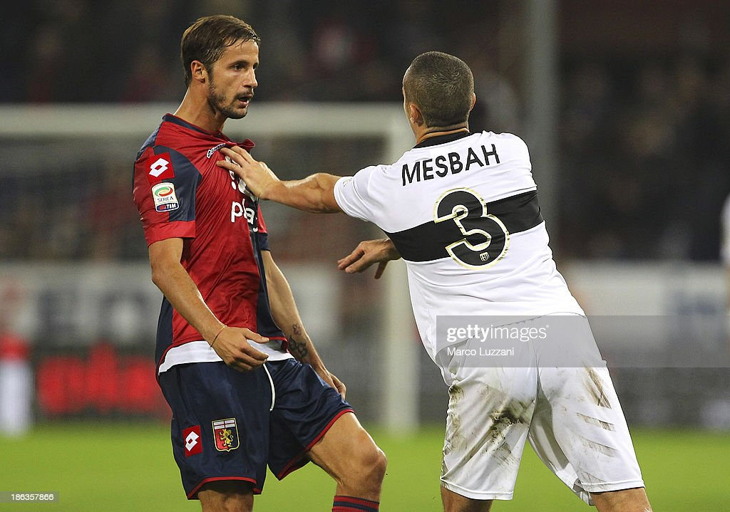 <a gi-track='captionPersonalityLinkClicked' href=/galleries/search?phrase=Djamel+Mesbah&family=editorial&specificpeople=6693283 ng-click='$event.stopPropagation()'>Djamel Mesbah</a> reacts with Luca Antonini (R) of Genoa CFC of Parma FC during the Serie A match between Genoa CFC and Parma FC at Stadio Luigi Ferraris on October 30, 2013 in Genoa, Italy.