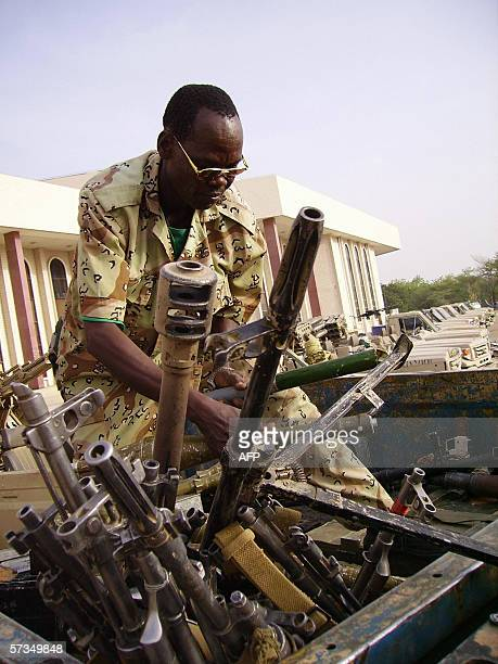 N'Djamena CHAD A government soldier displays weapons reportedly seized from rebel forces and shown to the media in the capital city N'Djamena 17...