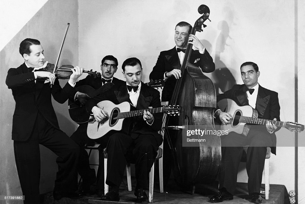 <a gi-track='captionPersonalityLinkClicked' href=/galleries/search?phrase=Django+Reinhardt&family=editorial&specificpeople=1567148 ng-click='$event.stopPropagation()'>Django Reinhardt</a> (1910-1953) and <a gi-track='captionPersonalityLinkClicked' href=/galleries/search?phrase=Stephane+Grappelli&family=editorial&specificpeople=897984 ng-click='$event.stopPropagation()'>Stephane Grappelli</a>, of the Quintet de Hot Club de France. Photograph, ca. 1934.