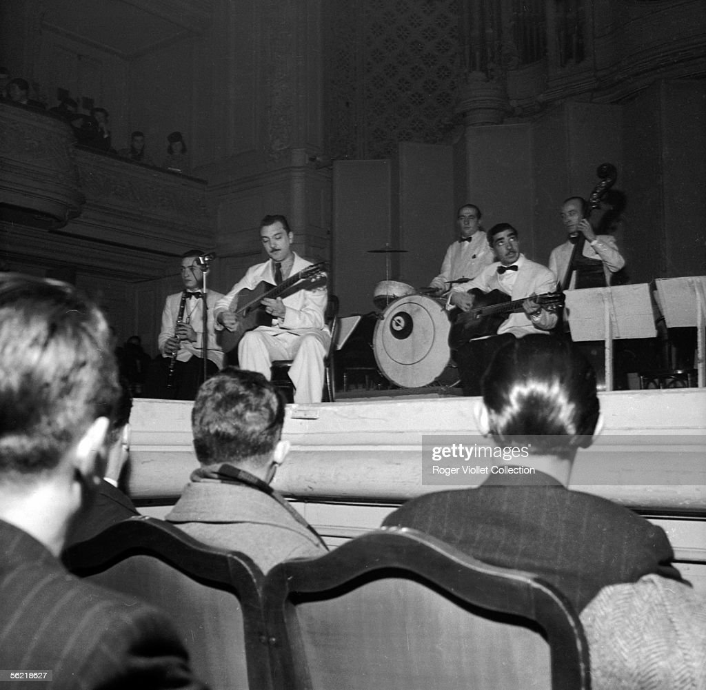 <a gi-track='captionPersonalityLinkClicked' href=/galleries/search?phrase=Django+Reinhardt&family=editorial&specificpeople=1567148 ng-click='$event.stopPropagation()'>Django Reinhardt</a> and the Hot Club of France. 1940.