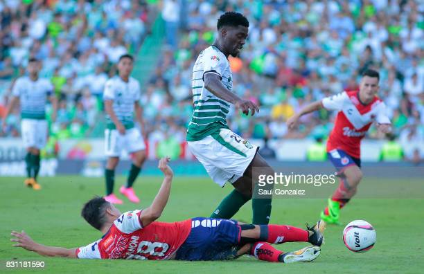 Djaniny Tavares of Santos and Jesus Paganoni of Veracruz fight for the ball during the 4th round match between Santos Laguna and Veracruz as part of...