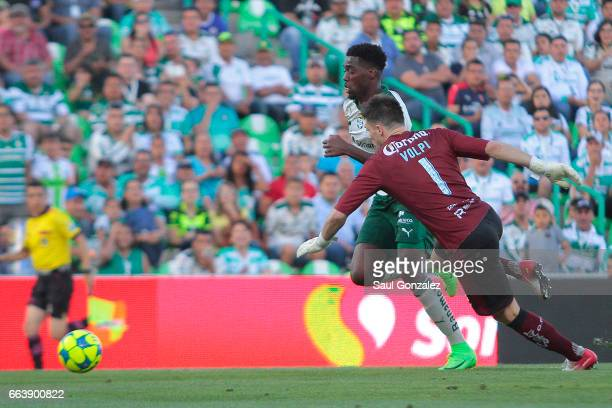Djaniny Tavares of Santos and Tiago Volpi of Queretaro compete for the ball during the 12th round match between Santos Laguna and Queretaro as part...