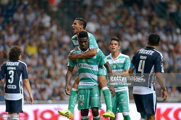 Djaniny Tavares of Santos celebrates with teammates after scoring the opening goal during a 6th round match between Monterrey and Santos Laguna as...