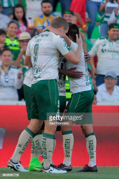 Djaniny Tavares of Santos celebrates with teammates after scoring the first goal of his team during the 12th round match between Santos Laguna and...