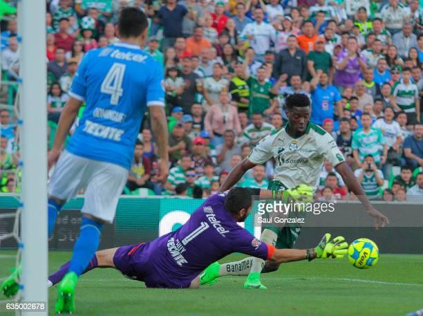 Djaniny Tavares of Santos fights for the ball with Jose Corona of Cruz Azul during the 6th round match between Santos Laguna and Cruz Azul as part of...