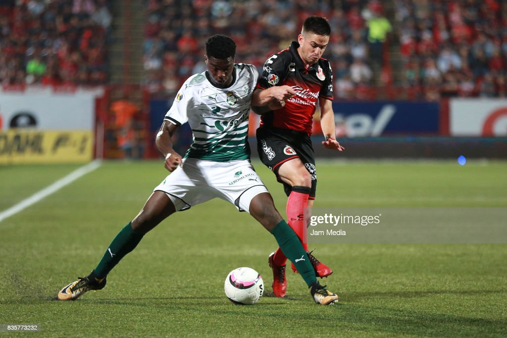 Djaniny Tavares (L) of Santos Laguna and Damian Perez (R) of Tijuana fight for the ball during the fifth round match between Tijuana and Santos Laguna as part of the Torneo Apertura 2017 Liga MX at Caliente Stadium on August 18, 2017 in Tijuana, Mexico.