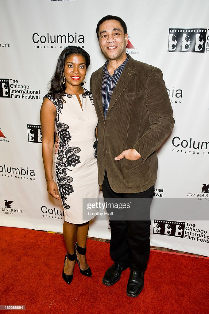 DjEna and Harry Lennix attends the 'H4' premiere at AMC River East Theater on October 19, 2013 in Chicago, Illinois.