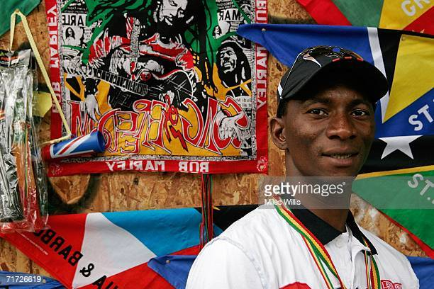 Djiba Diallo from Guinea sells flags horns and whistles during the Notting Hill Carnival on August 27 2006 in London England People from all over the...