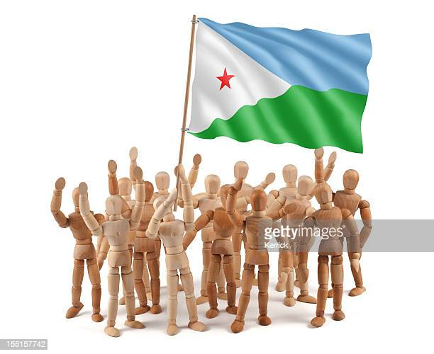 Djibouti - wooden mannequin group with flag
