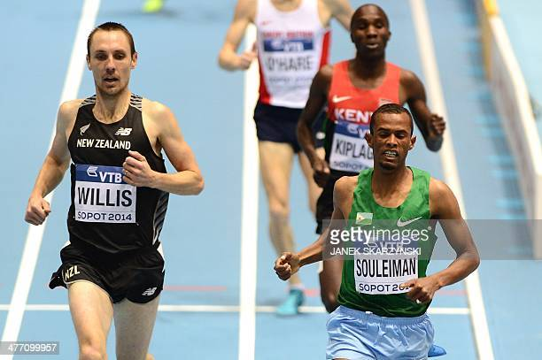 Djibouti's Ayanleh Souleiman competes with New Zealand's Nicholas Willis in the Men 1500 m heat 2 event at the IAAF World Indoor Athletics...