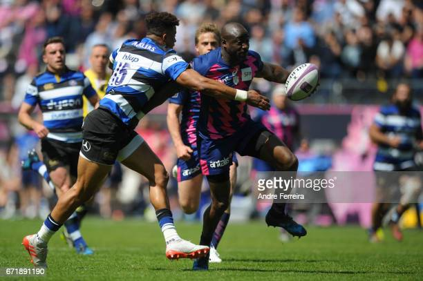 Djibril Camara of Stade Francais and Anthony Watson of Bath during the European Challenge Cup semi final between Stade Francais and Bath on April 23...