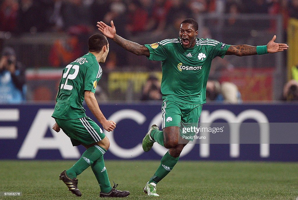 <a gi-track='captionPersonalityLinkClicked' href=/galleries/search?phrase=Djibril+Cisse&family=editorial&specificpeople=210952 ng-click='$event.stopPropagation()'>Djibril Cisse</a>' (R) and Stergos Marinos of Panathinaikos celebrate the third goal during the UEFA Europa League Round of 32, 2nd leg match between AS Roma and Panathinaikos on February 25, 2010 in Rome, Italy.