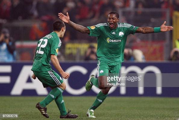Djibril Cisse' and Stergos Marinos of Panathinaikos celebrate the third goal during the UEFA Europa League Round of 32 2nd leg match between AS Roma...