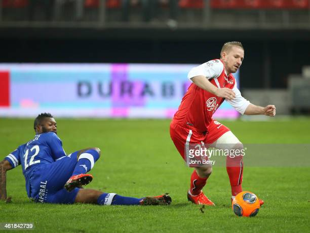 Djibril Cisse of Bastia and Rudy Mater of Valenciennes in action during the french Ligue 1 match between Valenciennes FC and SC Bastia at the Stade...