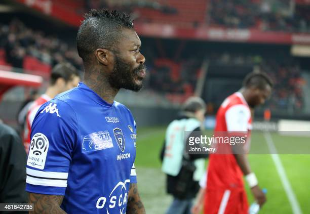 Djibril Cisse of Bastia enters the field prior to the french Ligue 1 match between Valenciennes FC and SC Bastia at the Stade du Hainaut on January...