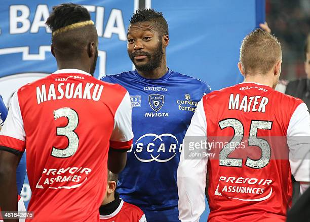 Djibril Cisse of Bastia poses with his teammates prior to the french Ligue 1 match between Valenciennes FC and SC Bastia at the Stade du Hainaut on...