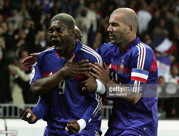 Djibril Cisse of France celebrates his goal with Zinedine Zidane and Sylvain Wiltord during the FIFA World Cup Qualifying Group Four match between...