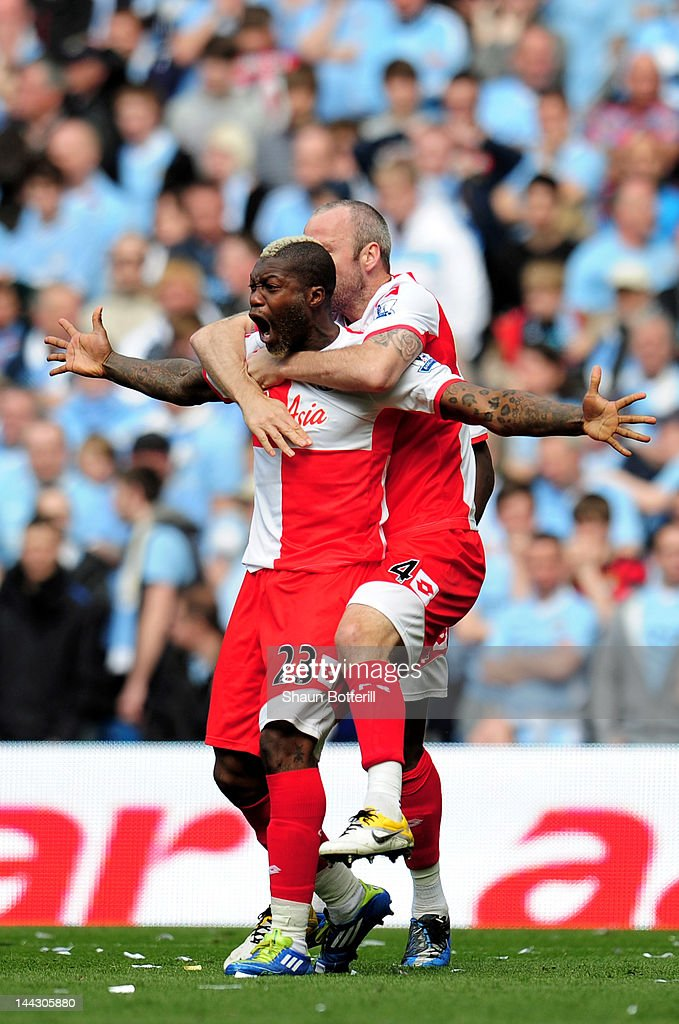 <a gi-track='captionPersonalityLinkClicked' href=/galleries/search?phrase=Djibril+Cisse&family=editorial&specificpeople=210952 ng-click='$event.stopPropagation()'>Djibril Cisse</a> of QPR celebrates with teammate <a gi-track='captionPersonalityLinkClicked' href=/galleries/search?phrase=Shaun+Derry&family=editorial&specificpeople=235813 ng-click='$event.stopPropagation()'>Shaun Derry</a> (R) after scoring his team's first goal during the Barclays Premier League match between Manchester City and Queens Park Rangers at the Etihad Stadium on May 13, 2012 in Manchester, England.