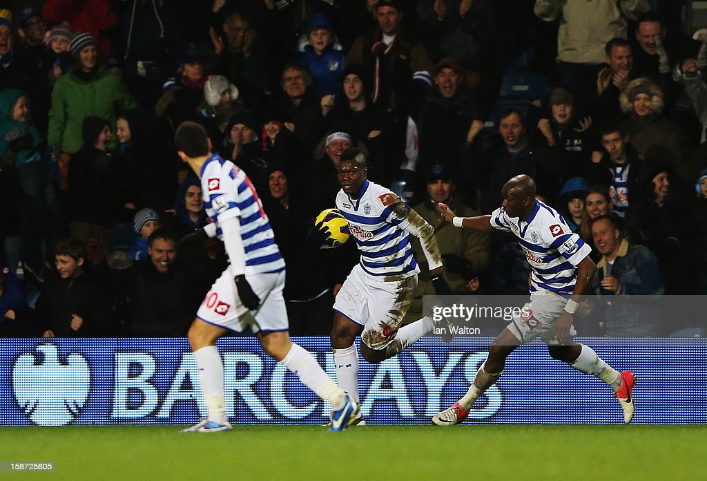 <a gi-track='captionPersonalityLinkClicked' href=/galleries/search?phrase=Djibril+Cisse&family=editorial&specificpeople=210952 ng-click='$event.stopPropagation()'>Djibril Cisse</a> (C) of Queens Park Rangers celebrates scoring during the Barclays Premier League match between Queens Park Rangers and West Bromwich Albion at Loftus Road on December 26, 2012 in London, England.