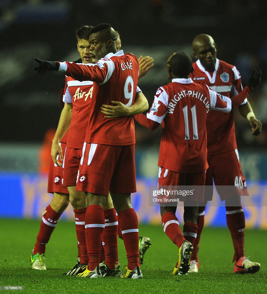 Djibril Cisse of Queens Park Rangers celebrates scoring his team's second goal with his team-mates during the Barclays Premier League match between Wigan Athletic and Queens Park Rangers at the DW Stadium on December 8, 2012 in Wigan, England.