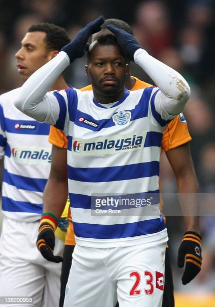 Djibril Cisse of Queens Park Rangers looks on in disbelief after he is shown a red card by referee Mark Clattenburg during the Barclays Premier...