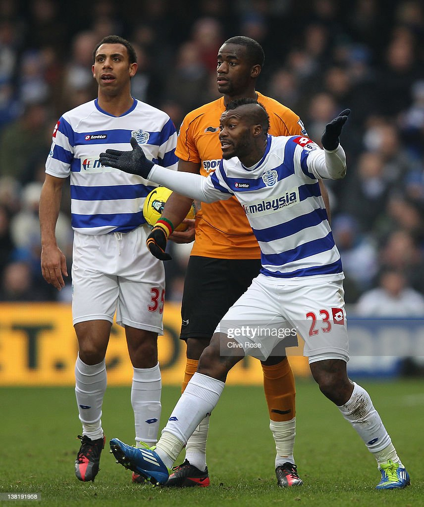 <a gi-track='captionPersonalityLinkClicked' href=/galleries/search?phrase=Djibril+Cisse&family=editorial&specificpeople=210952 ng-click='$event.stopPropagation()'>Djibril Cisse</a> of Queens Park Rangers reacts after he is shown a red card by referee <a gi-track='captionPersonalityLinkClicked' href=/galleries/search?phrase=Mark+Clattenburg&family=editorial&specificpeople=2108870 ng-click='$event.stopPropagation()'>Mark Clattenburg</a> during the Barclays Premier League match between Queens Park Rangers and Wolverhampton Wanderers at Loftus Road on February 4, 2012 in London, England.