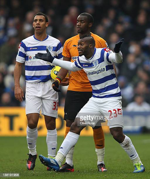 Djibril Cisse of Queens Park Rangers reacts after he is shown a red card by referee Mark Clattenburg during the Barclays Premier League match between...