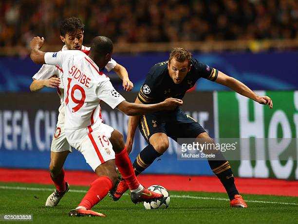 Djibril Sidibe of AS Monaco and Harry Kane of Tottenham Hotspur challenge for the ball during the UEFA Champions League Group E match between AS...