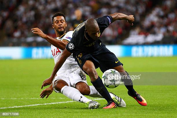 Djibril Sidibe of AS Monaco is challenged by Mousa Dembele of Tottenham Hotspur during the UEFA Champions League match between Tottenham Hotspur FC...