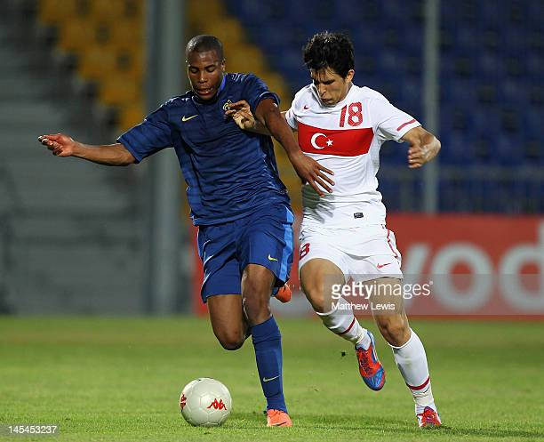 Djibril Sidibe of France and Necip Uysal of Turkey challenge for the ball during the Toulon Tournament Semi Final match between France and Turkey at...