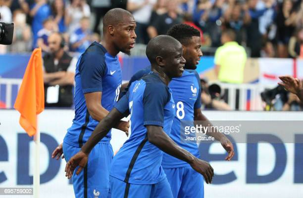Djibril Sidibe of France celebrates his goal with N'Golo Kante and Thomas Lemar during the international friendly match between France and England at...
