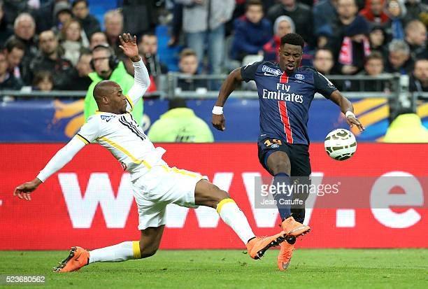 Djibril Sidibe of Lille and Serge Aurier of PSG in action during the French League Cup final between Paris SaintGermain and Lille OSC at Stade de...