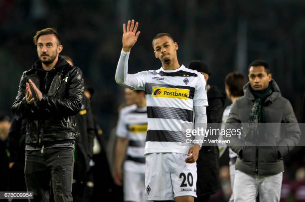 Djibril Sow and JOsip Drmic of Borussia Moenchengladbach look disappointed after the DFB Cup Semi Final between Borussia Moenchengladbach and...