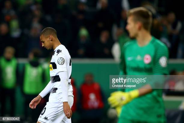 Djibril Sow of Moenchengladbach looks dejected during penalty shoot out during the DFB Cup semi final match between Borussia Moenchengladbach and...