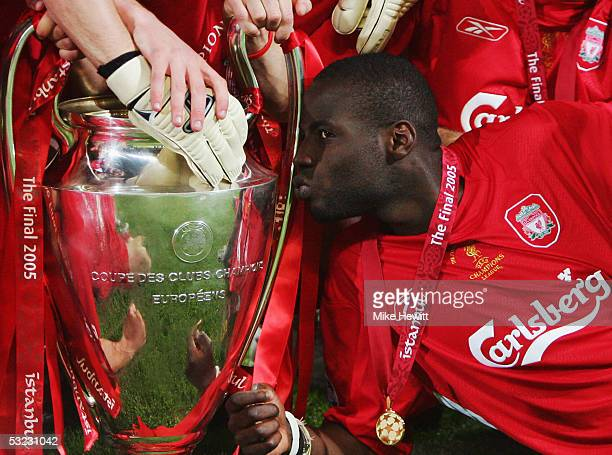 Djimi Traore of Liverpool kisses the trophy as he celebrates with team mates following victory in the UEFA Champions League Final between Liverpool...