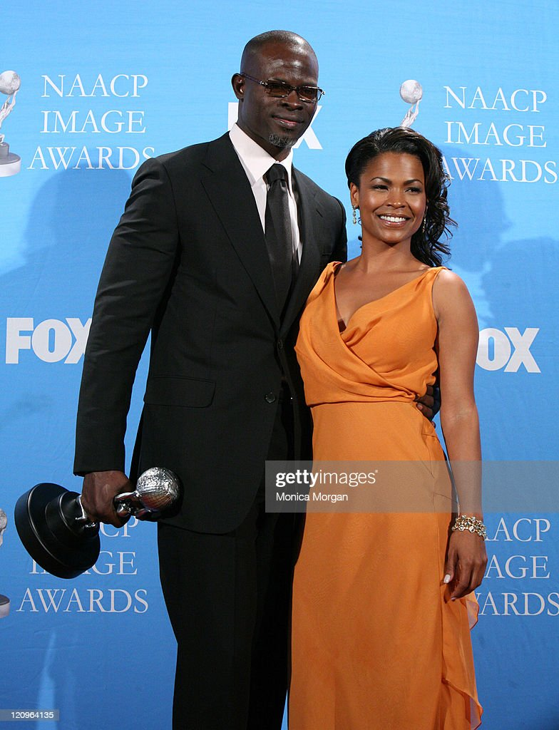 Djimon Hounsou and Nia Long during 38th Annual NAACP Image Awards - Press Room at Shrine Auditorium in Los Angeles, California, United States.