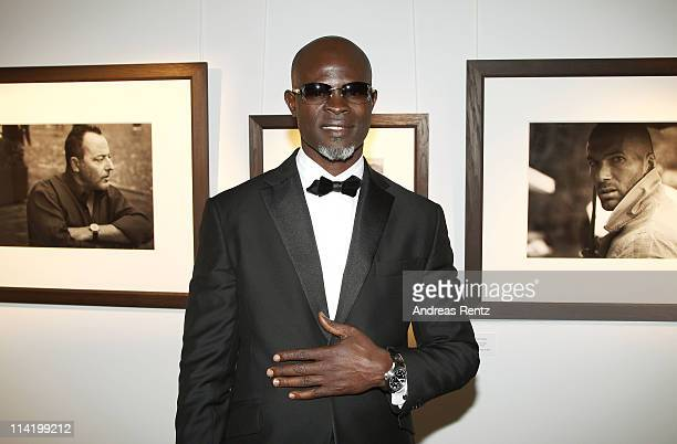 Djimon Hounsou attends the IWC Presents Peter Lindbergh Exhibition during the 64th Cannes Film Festival on May 15 2011 in Cannes France