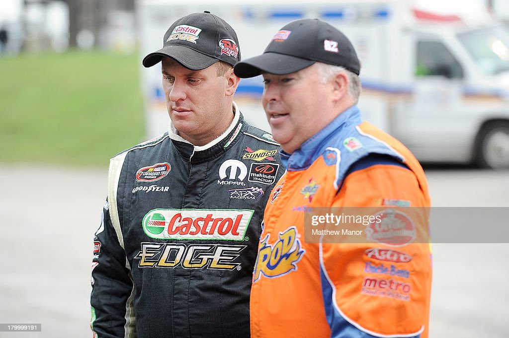 D.J.Kennington (L), driver of the #17 Castrol Edge/Mahindra Tractors Dodge, talks with Dave Connelly, driver of the #28 Schneider's/Metro Dodge car prior to practice for the NASCAR Canadian Tire Series race at Barrie Speedway on September 7, 2013 in Oro Station, Ontario, Canada.