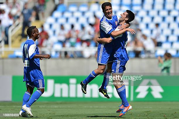 Djokovic and former player Bebeto celebrate a goal during the Jogo das Estrelas Charity Soccer Match between Friends of former player Petkovic and...