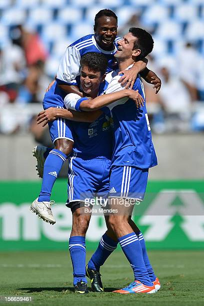 Djokovic former player Bebeto and Edilson celebrate a goal during the Jogo das Estrelas Charity Soccer Match between Friends of former player...
