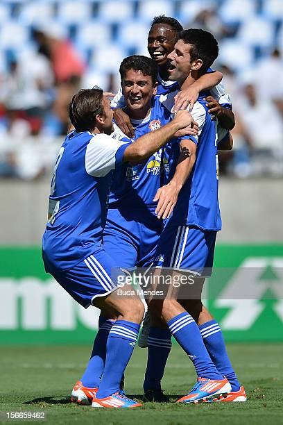 Djokovic former player Bebeto Edilson and Petkovic celebrate a goal during the Jogo das Estrelas Charity Soccer Match between Friends of former...