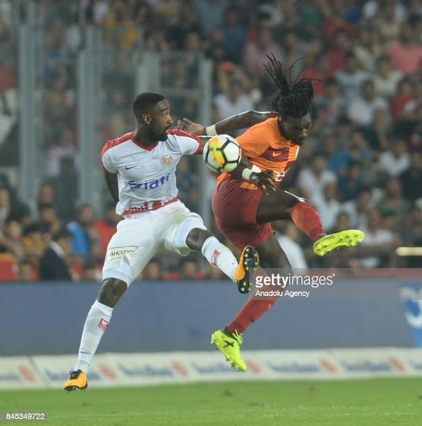 Djourou of Antalyaspor in action against Bafétimbi Gomis of Galatasaray during the 4th week of the Turkish Super Lig match between Antalyaspor and...