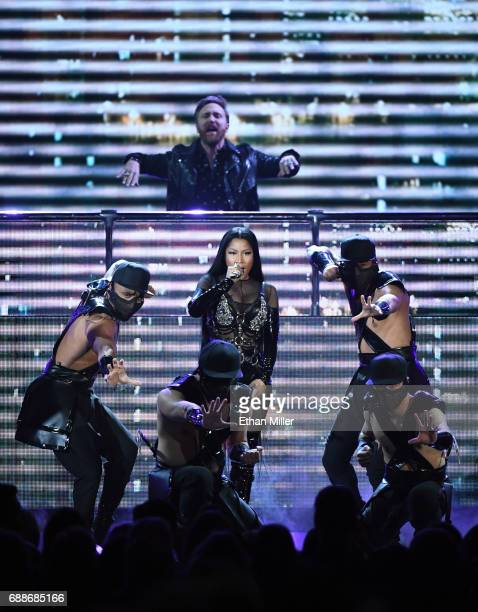 DJ/producer David Guetta and rapper Nicki Minaj perform with dancers during the 2017 Billboard Music Awards at TMobile Arena on May 21 2017 in Las...