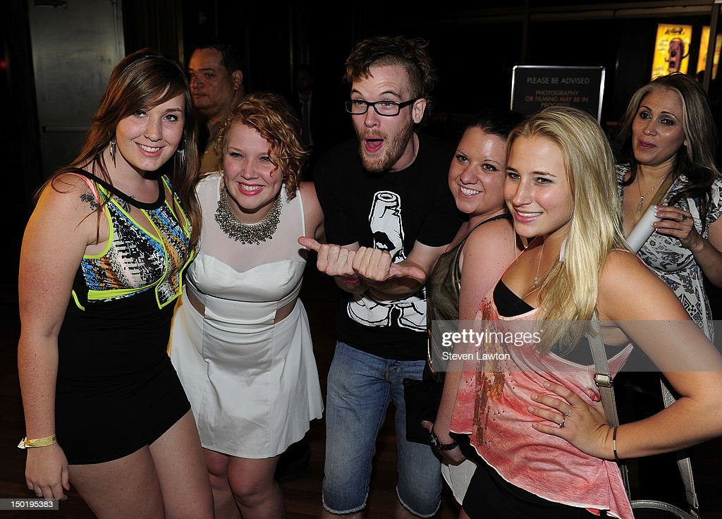 DJ/producer Rusko (C) arrives to perform at Rain at Palms Resort & Casino on August 11, 2012 in Las Vegas, Nevada.